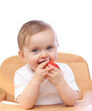 Baby girl with apple Stock Images