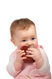 Baby girl with an apple Stock Images