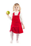 Baby girl with apple royalty free stock photography