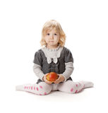 Baby girl with apple stock image
