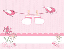 Baby girl arrival announcement card. Baby booties carried on a clothesline by cute birds is sure to welcome the arrival of a new baby girl Stock Image