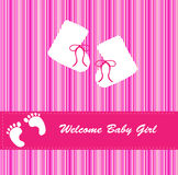 Baby Girl Arrival Announcement Card. New baby girl arrival announcement card in pink and white stripes with footprints and bootees Royalty Free Stock Photo