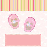 Baby girl arrival card with shoes Stock Photo