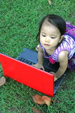 Baby girl asian play computer Stock Images