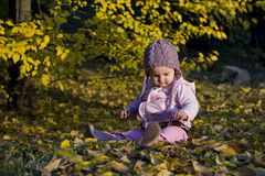 Baby girl in autumn. Beautiful baby girl playing in an autumn park Royalty Free Stock Photography