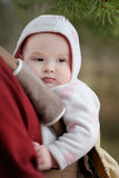 Baby girl in a baby carrier Stock Photo