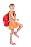 Baby girl with backpack goes to school. Isolated on white background Stock Photos