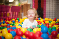 Baby girl in ball pool Stock Photography