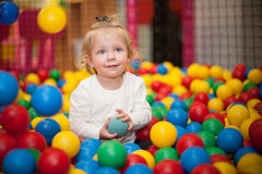 Baby girl in ball pool Royalty Free Stock Photos