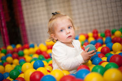 Baby girl in ball pool Royalty Free Stock Photo