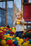 Baby girl in ball pool Royalty Free Stock Photography