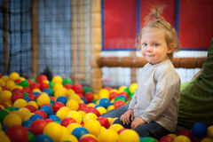 Baby girl in ball pool Stock Photos