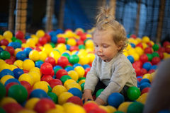 Baby girl in ball pool Stock Images