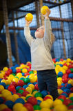 Baby girl in ball pool. Little child in a ball pool Royalty Free Stock Photo