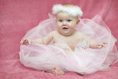 Baby girl ballerina. In dress on rink background Stock Image