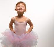 Baby girl ballerina. Girl in pink ballerina dress smiling Stock Images