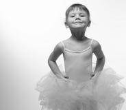 Baby girl ballerina. Girl in ballerina dress smiling Stock Photos