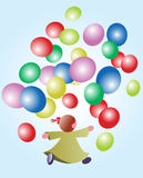 Baby girl with balloons. Girl plays with coloured balloons Royalty Free Stock Photography