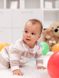 Baby girl with balloons Royalty Free Stock Image