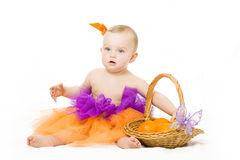 Baby girl with basket Royalty Free Stock Images