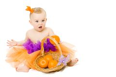Baby girl with basket Stock Photos