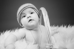 A baby girl in a basket Stock Image