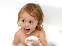 Baby girl in the bath Stock Photos