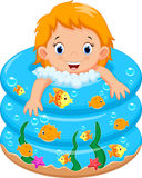 Baby girl bath in a bathtub with lot of soap Stock Photo