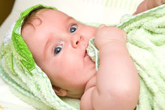 Baby girl with bath towel Stock Images