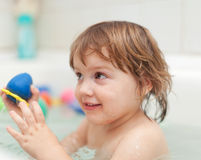 Baby girl bathes  in bath Royalty Free Stock Images