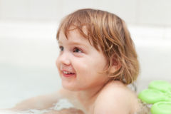 Baby girl bathes in bathtub Stock Photography