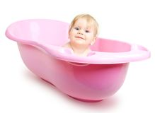 Baby girl bathing in the bath Royalty Free Stock Image