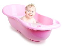 Baby girl bathing in the bath Stock Photography
