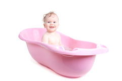 Baby girl bathing in the bath Stock Image