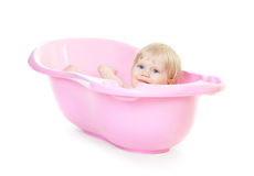 Baby girl bathing in the bath Royalty Free Stock Images
