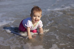 Baby girl at beach stock image