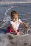 Baby girl at beach stock images