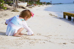 A baby girl on the beach Stock Photo