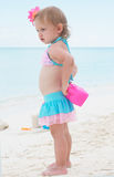 A baby girl on the beach Royalty Free Stock Images
