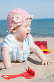 Baby. Girl on the beach royalty free stock image