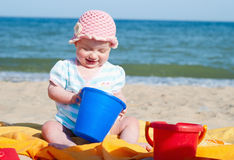 Baby. Girl on the beach stock images