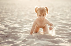 Baby girl on the beach Royalty Free Stock Photo