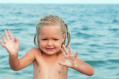 Baby girl on beach. Stock Photo