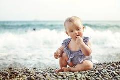 Baby girl on the beach Stock Photo