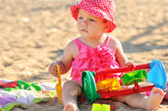 Baby girl on the beach Stock Photo