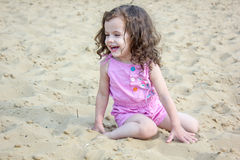 Baby girl on a beach laughing Royalty Free Stock Photo