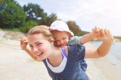 Baby girl beach. Little girl l at the beach having fun stock photography