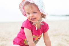 Baby girl beach. Little baby girl at the beach and laughing royalty free stock photography