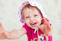 Baby girl beach. Little baby girl at the beach and laughing stock photography
