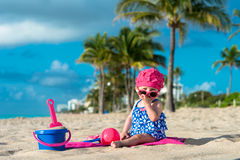 Baby Girl on Beach. Baby girl peeking over sunglasses on beach stock photo
